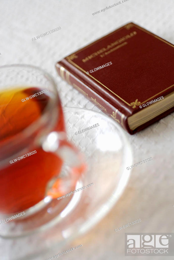 Stock Photo: Close-up of black tea near a book.