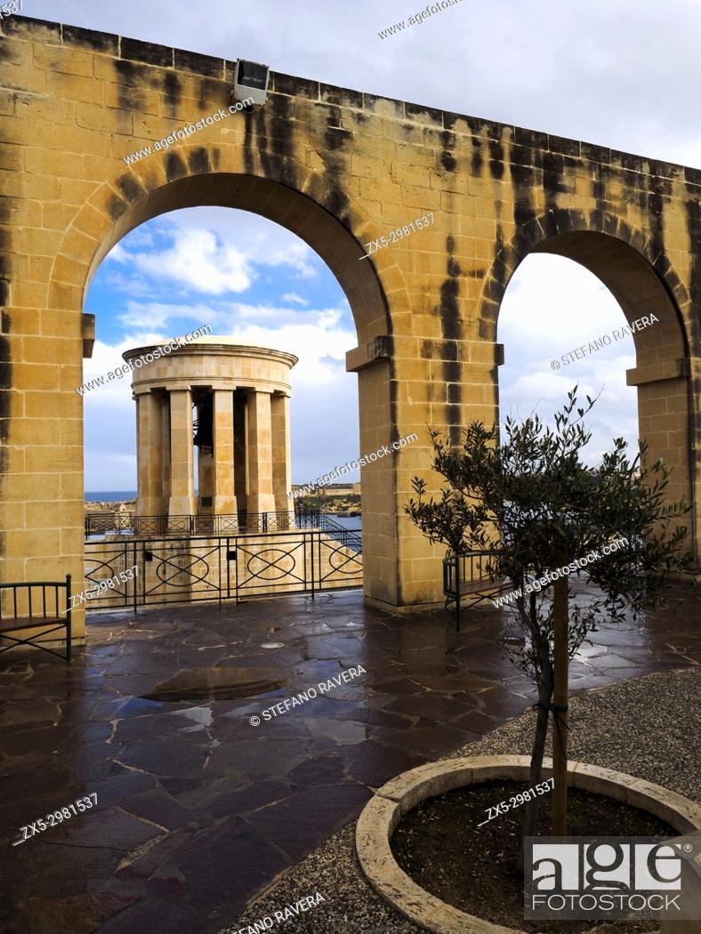Stock Photo: The Siege bell monument, a World War II Memorial site in the Upper Barakka gardens - Valletta, Malta.