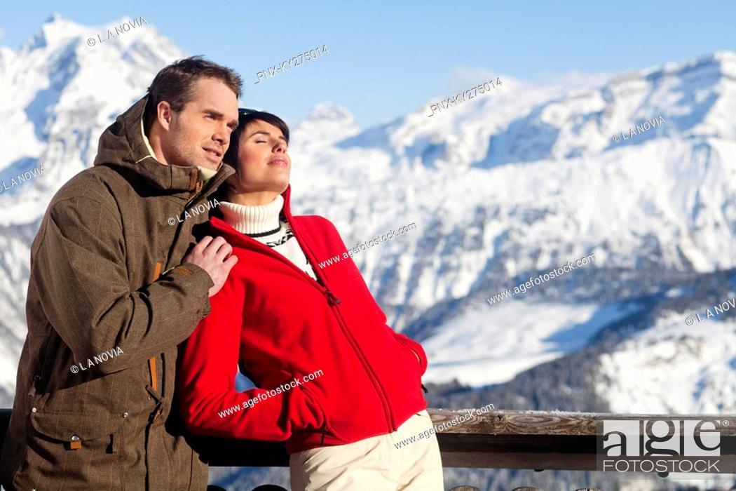 Stock Photo: Young couple enjoying winter sun.