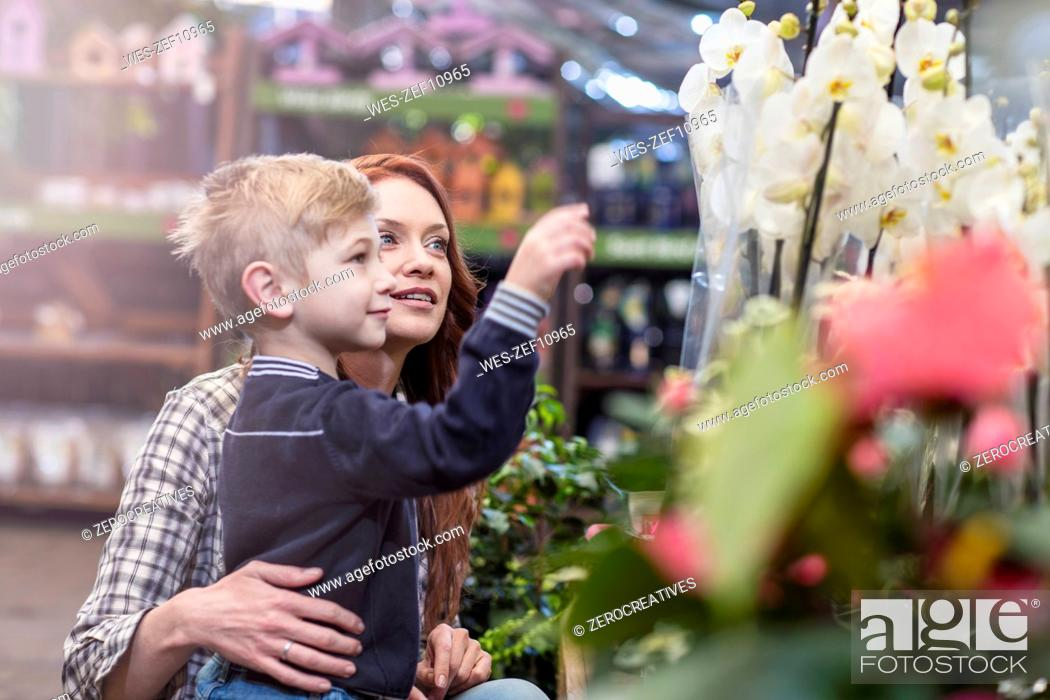 Stock Photo: Mother and son at garden centre.
