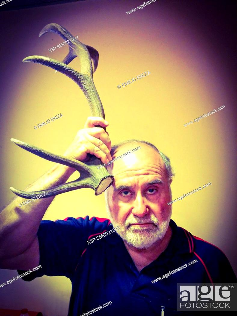 Stock Photo: Old man with a horn.