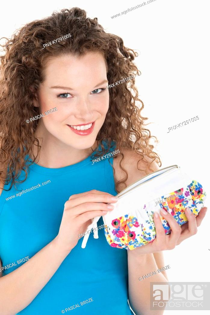Stock Photo: Portrait of a woman holding a purse.