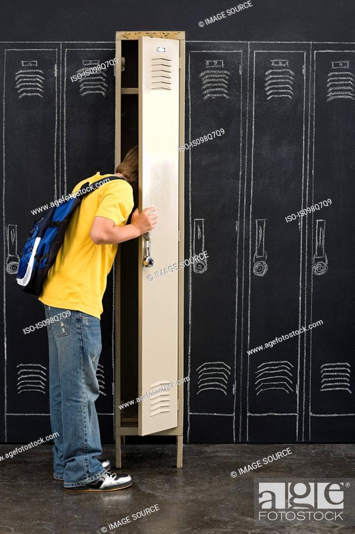 Stock Photo: Boy looking in locker.