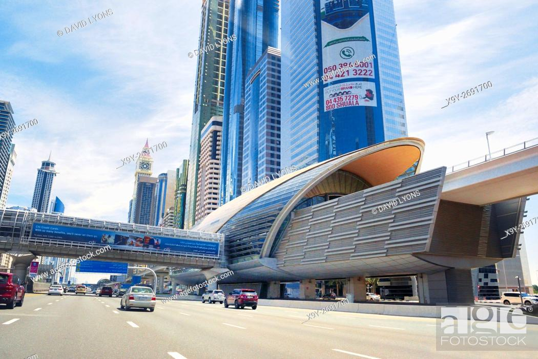 Stock Photo: City of Dubai. Financial Centre Metro Station on Sheikh Zayed Road. Al Yaquob Tower in distance. United Arab Emirates.