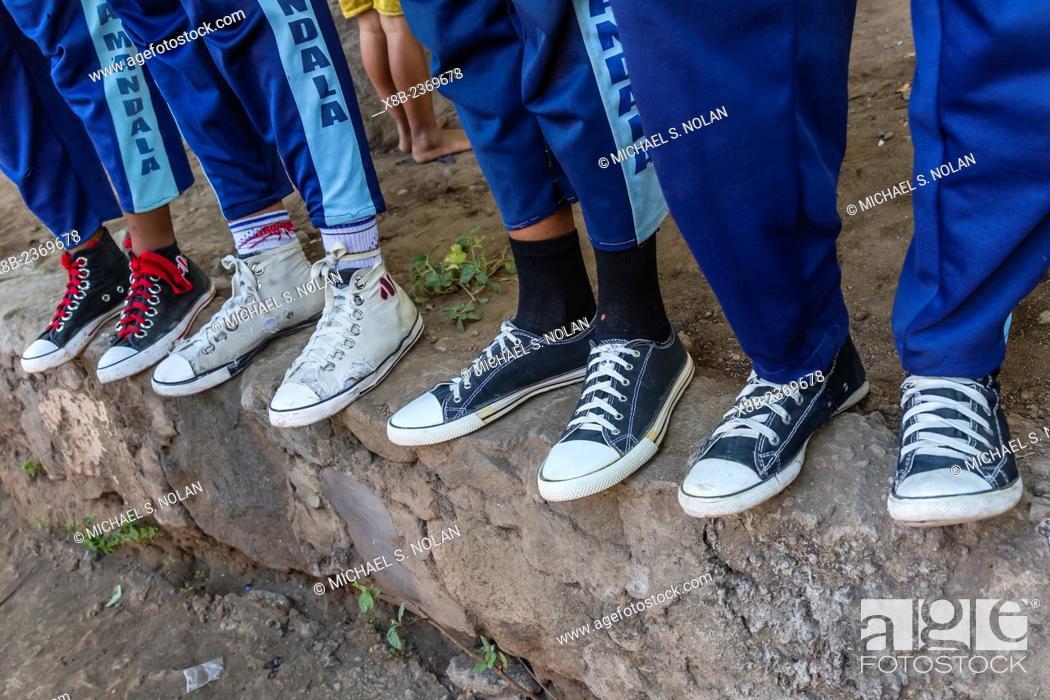 Stock Photo: Shoes of school children in Mudakeputu village, just outside Larantuka, capital city of Flores Island, Indonesia.