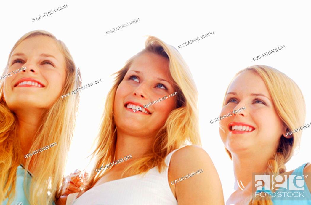 Stock Photo: Three women standing together.