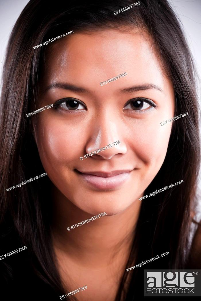 Stock Photo: An isolated shot of a beautiful happy asian woman.