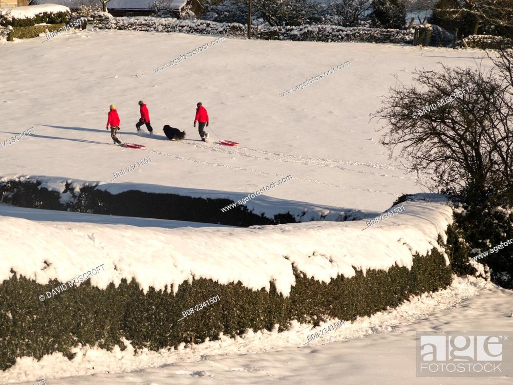 Stock Photo: people walking in snow, near Matlock, Derbyshire, Britain (December 2014).