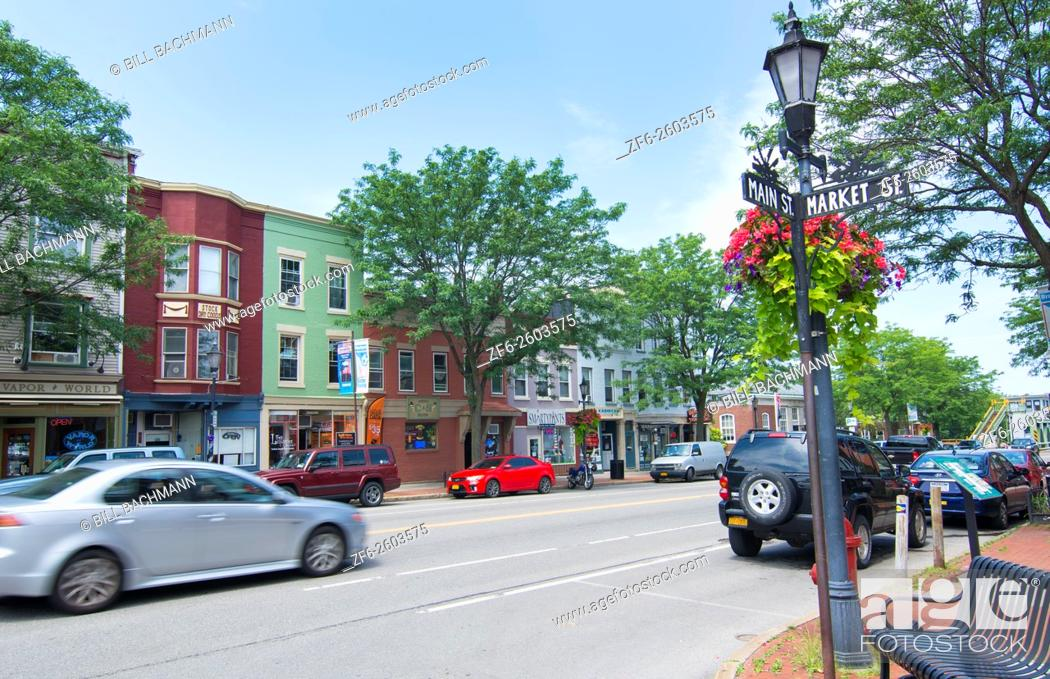 Stock Photo: Brockport New York NY small town with downtown with traffic on Main Street in college town village and Victorian Village on the Erie Canal.