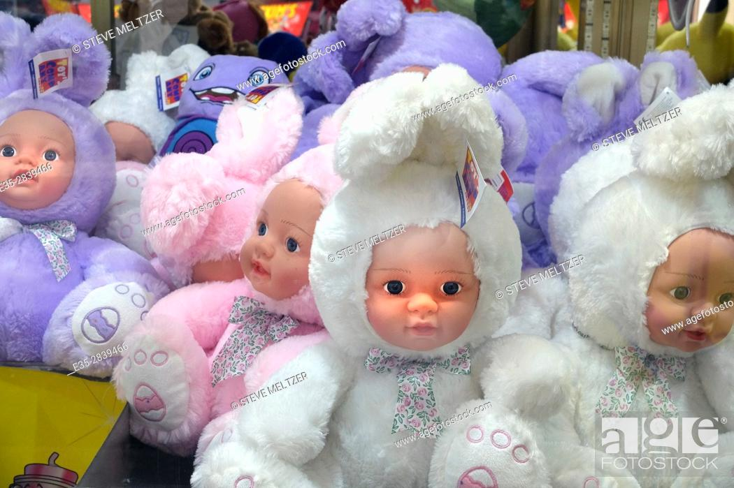 Stock Photo: Strange dolls are offered as prizes at an amusement park.