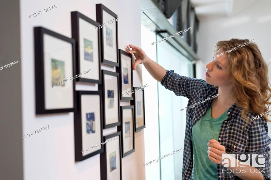 Stock Photo: Interior designer measuring painting size.