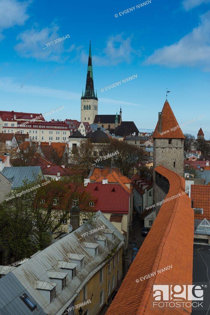 Stock Photo: Tallinn skyline with city wall towers and Oleviste church.