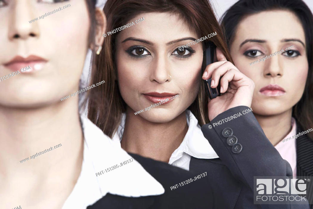 Stock Photo: Close-up of three businesswomen.