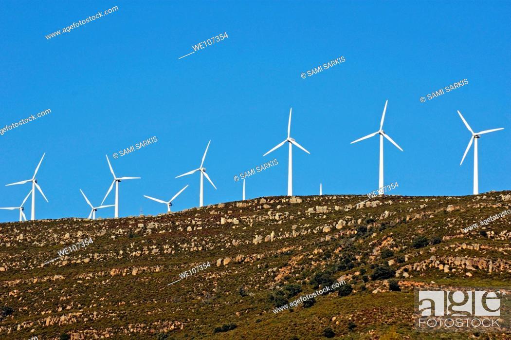 Stock Photo: Wind turbines on ridge above the Playa De Los Lances, Tarifa, Andalusia, Spain.