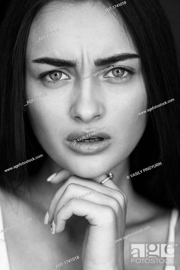 Stock Photo: Close-up portrait of confused young woman.