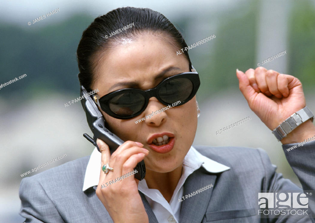 Stock Photo: Woman holding cell phone, portrait.