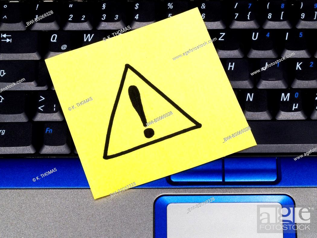 memo note on notebook, danger exclamation mark in triangle