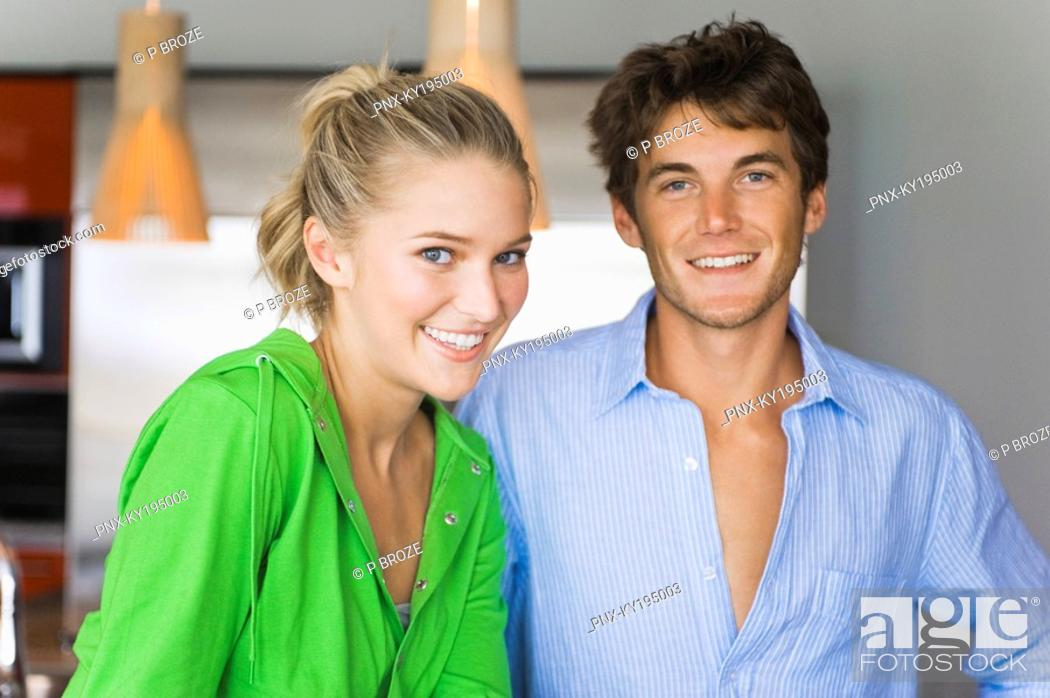 Stock Photo: Portrait of a couple in the kitchen and smiling.