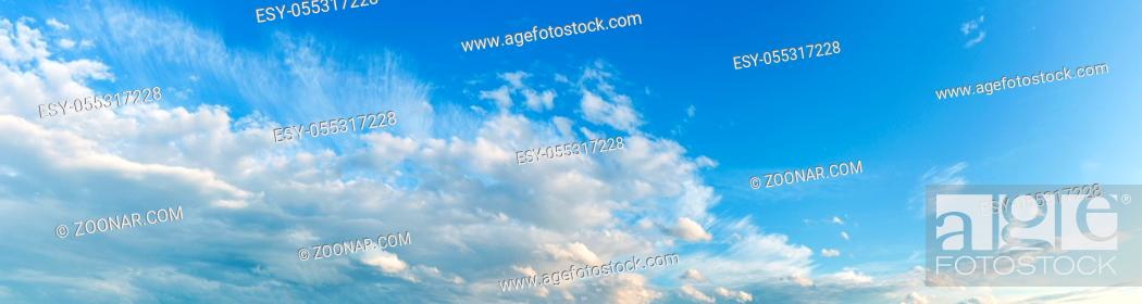 Photo de stock: White clouds in the blue azure sky. Summer good weather background.