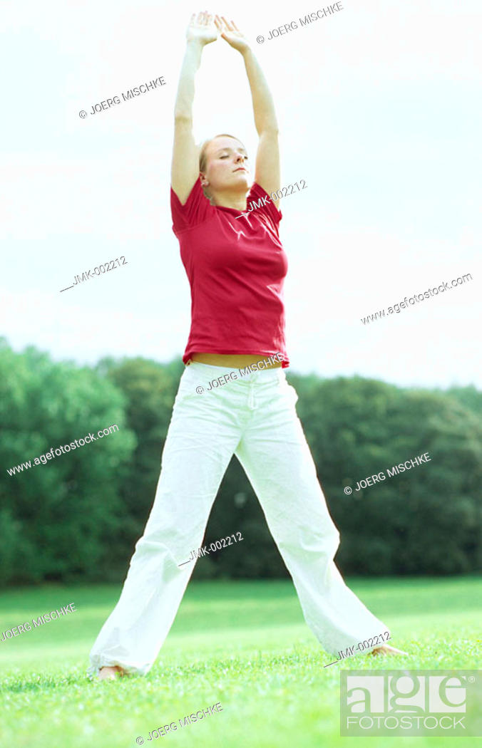 Stock Photo: A young woman, 15-20 20-25 25-30 years old, practicing Yoga, Tai Chi, Qi Gong.