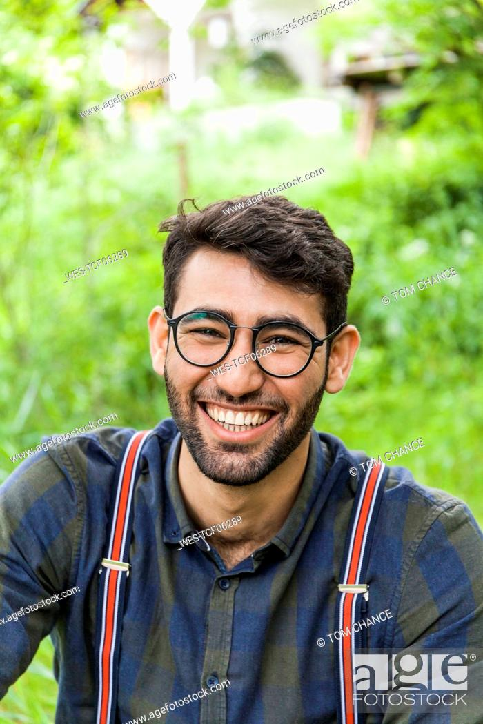 Photo de stock: Portrait of laughing young man wearing glasses.