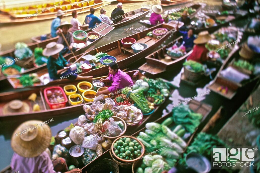 Stock Photo: Vendors' boats are tightly packed at a floating market on a side canal of the Chao Phraya River in Bangkok, Thailand.