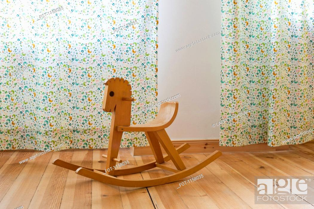 Stock Photo: A rocking horse in a domestic room.