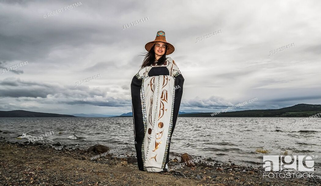 Stock Photo: Tlingit first nation woman in traditional wardrobe on the shores of Teslin Lake; Teslin, Yukon, Canada.