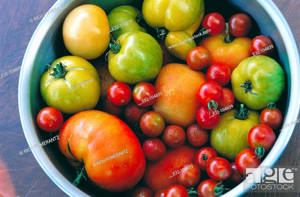 Stock Photo: Tomatoes: red carmelo, green zebra and cherry.
