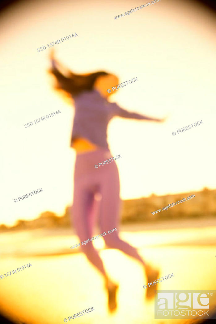 Stock Photo: Low angle view of a young woman dancing.