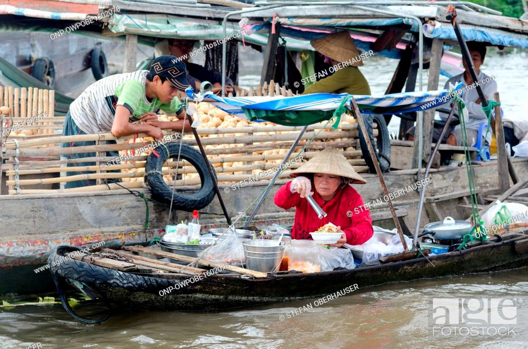 Stock Photo: Vietnam, Can Tho, market woman in the floating markets in the Mekong Delta of Vietnam.