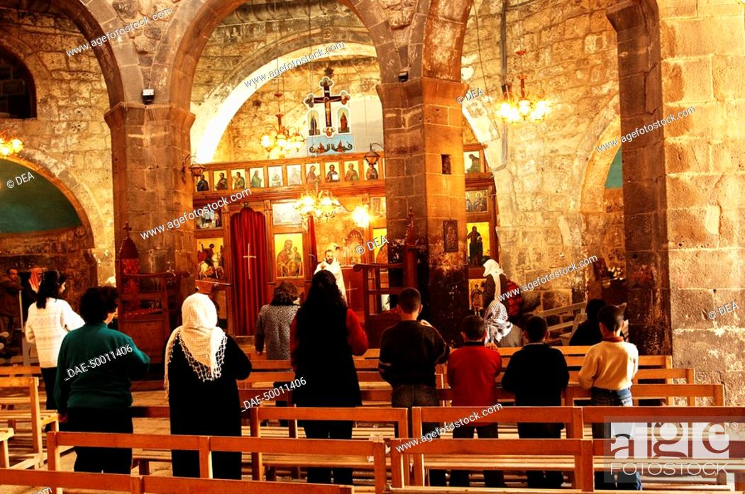 Stock Photo: Syria - Damascus - Izra'. Church of St. George, 515 AD. Interior, celebration of Mass.