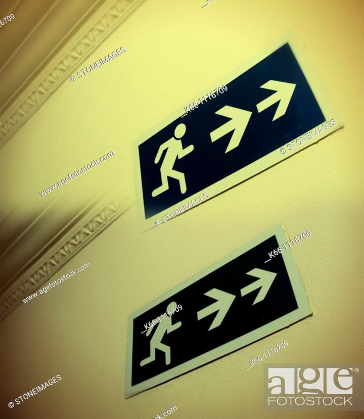 Stock Photo: Two exit signs.