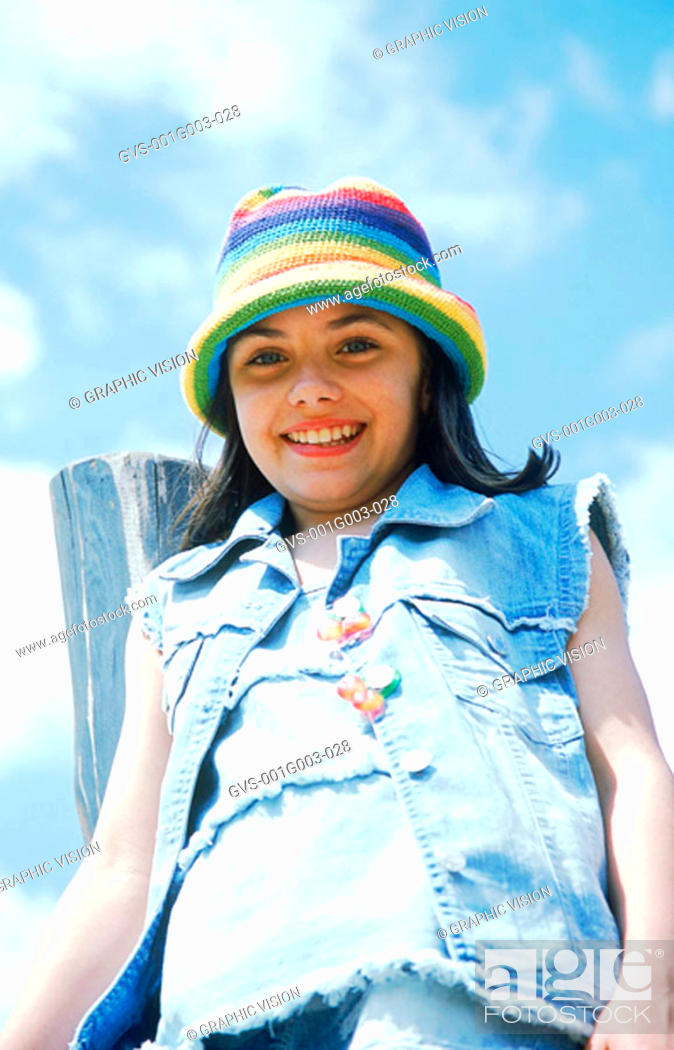Stock Photo: Low angle view of a young girl smiling.