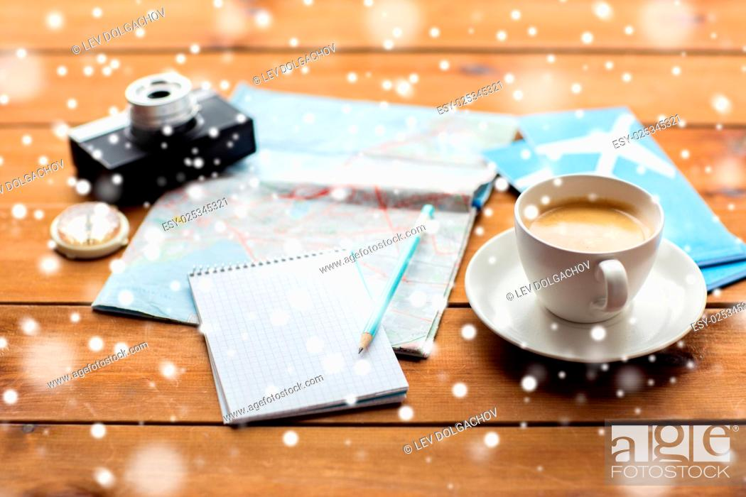 Stock Photo: vacation, tourism, travel, winter holidays and objects concept - close up of blank notepad with map, coffee and airplane tickets.