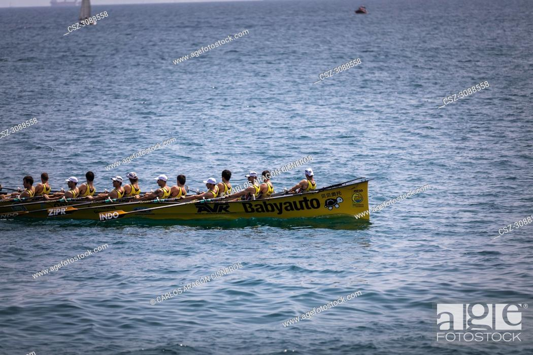 Stock Photo: CASTRO URDIALES, SPAIN - JULY 15, 2018: Competition of boats, regata of trainera, Orio Babyauto boat in action in the VI Bandera CaixaBank competition.