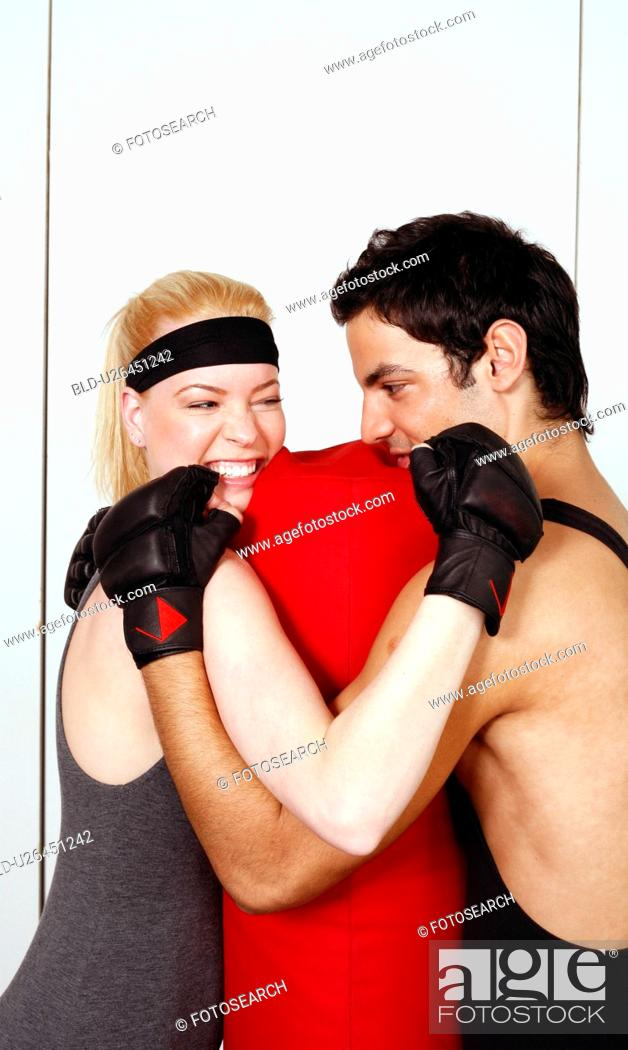 Stock Photo: Young man and woman flirting in a fitness class.