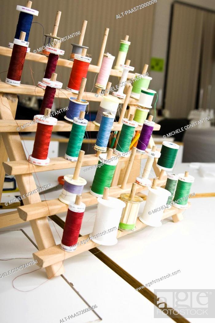 Stock Photo: Spools of thread on rack.