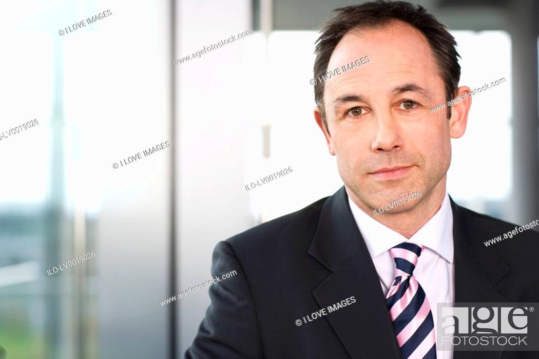Stock Photo: Portrait of a businessman in a suit.