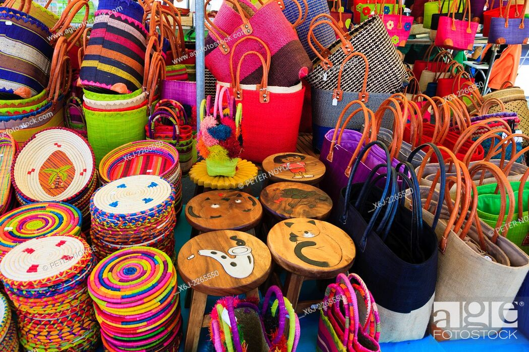 Stock Photo: Colourful bags and place mats on market stall.