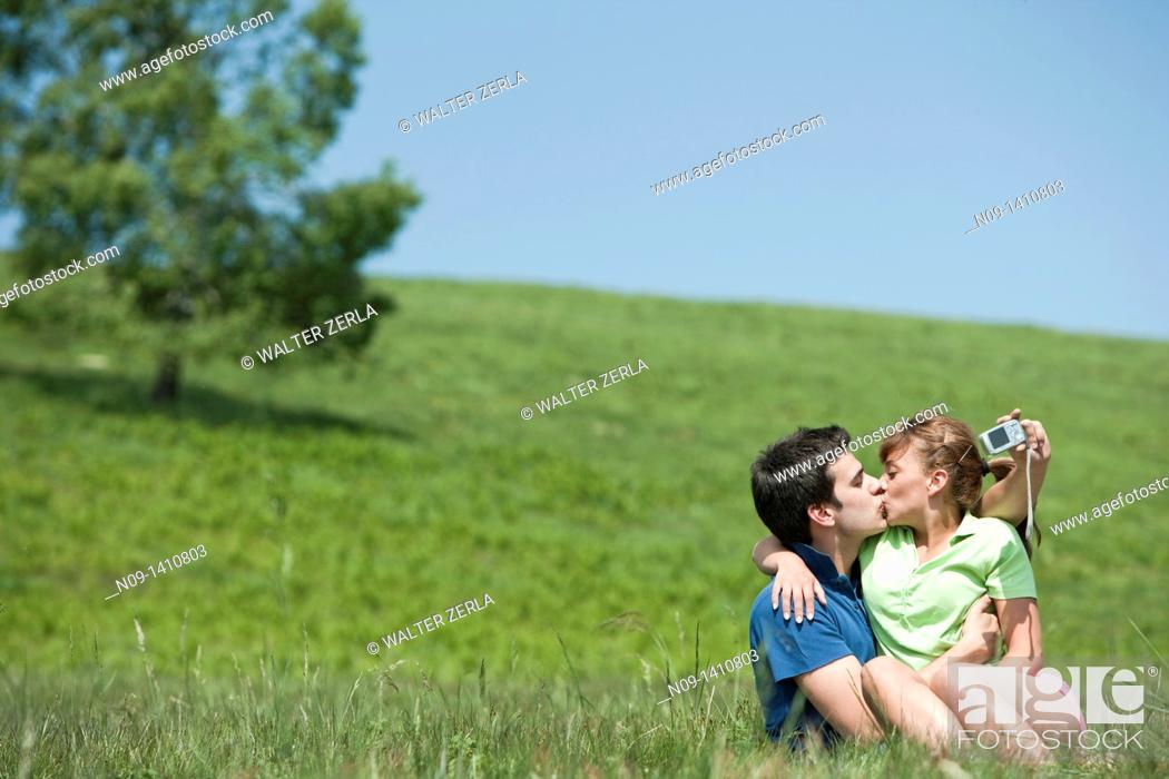 Stock Photo: Couple kissing outdoors.