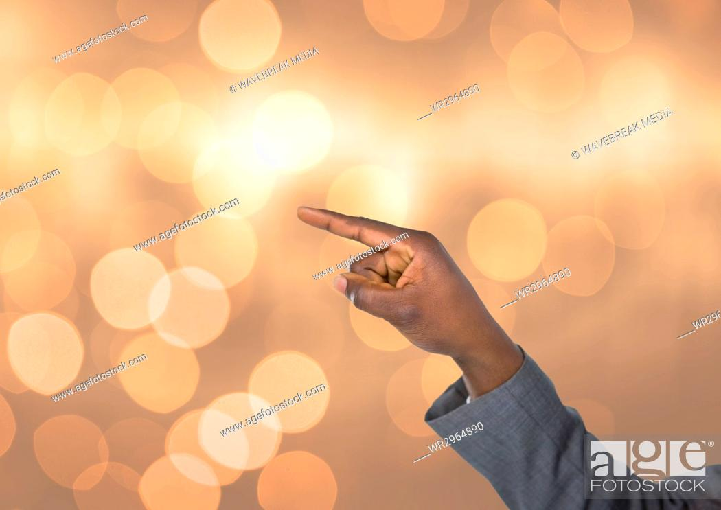 Stock Photo: Hand pointing angular with sparkling light bokeh background.
