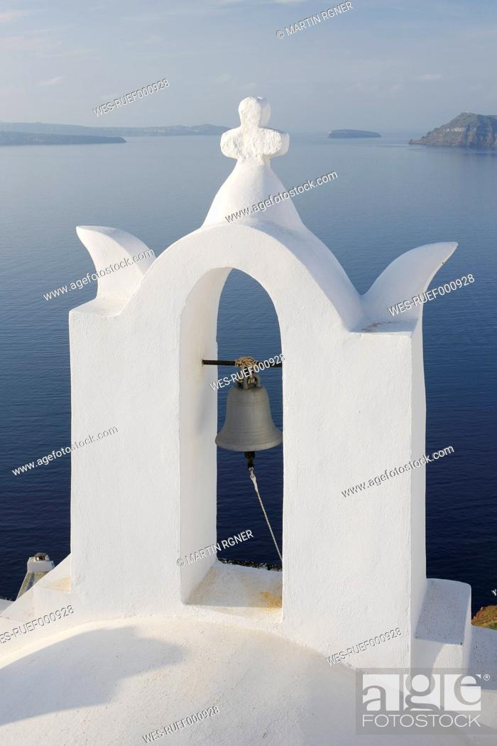 Stock Photo: Greece, Bell tower in front of caldera at Oia.