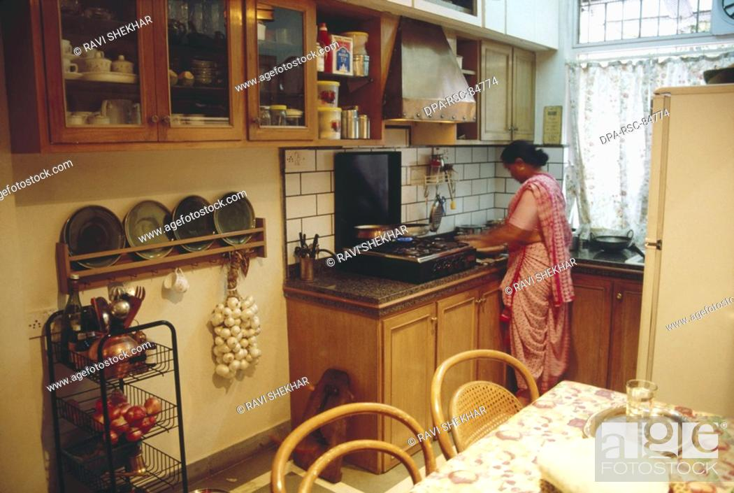 Woman Making Food In Kitchen Higher Middle Class Family