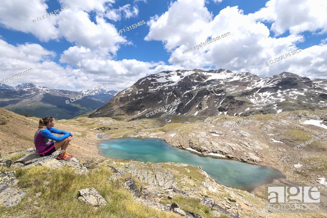 Stock Photo: The hiker admiring the view of Bei Laghetti in Sobretta Valley, Santa Caterina Valfurva, Province of Sondrio, Valtellina, Lombardy, Italy, Europe.