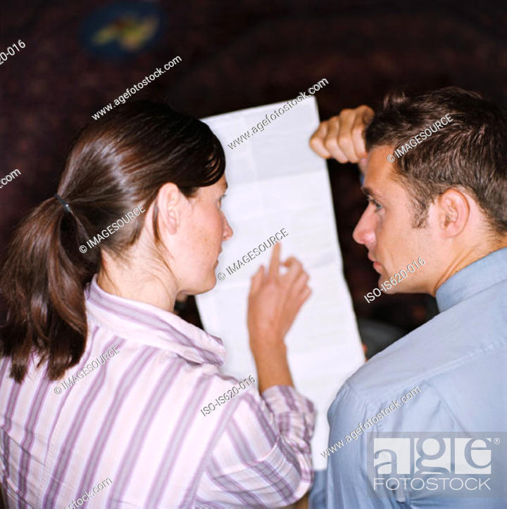Stock Photo: Couple planning their finances.