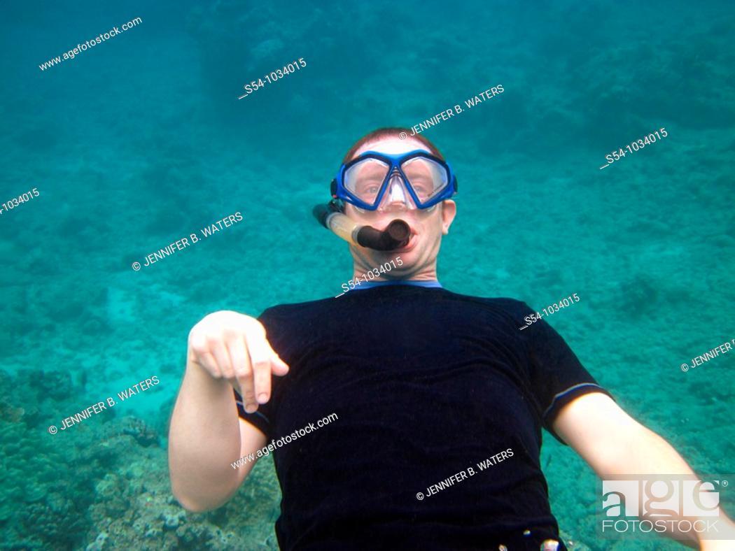 Stock Photo: A man snorkeling at Hanauma Bay, Oahu, Hawaii.