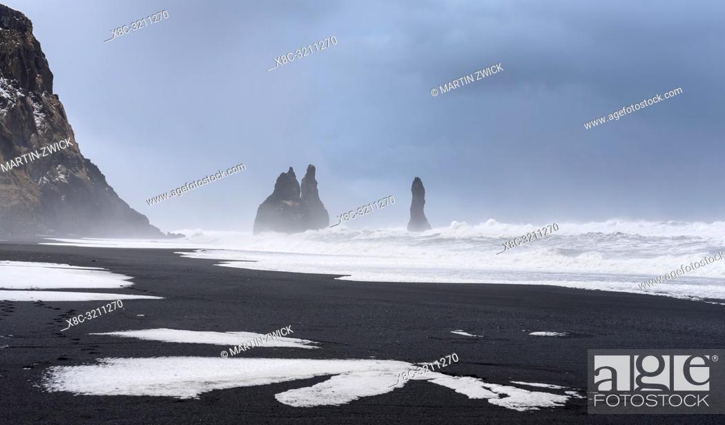 Stock Photo: The coast of the north atlantic near Vik y Myrdal during winter. Black volcanic beach Reynisfjara with the sea stacks Reynisdrangar.