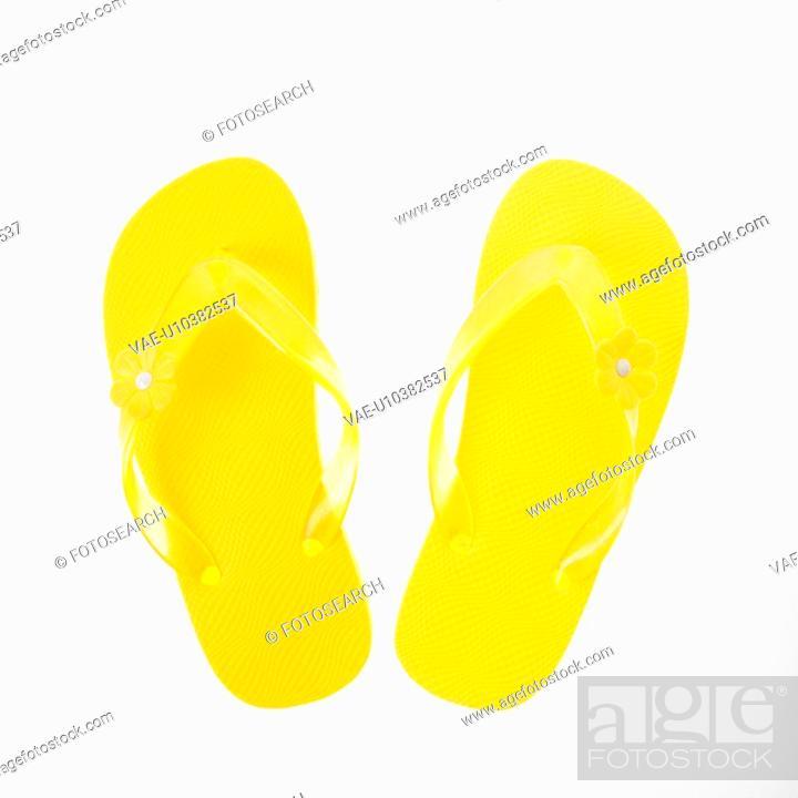 Stock Photo: Yellow plastic thong sandals.