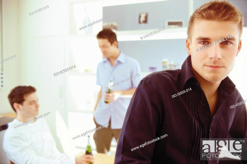 Stock Photo: Men drinking.